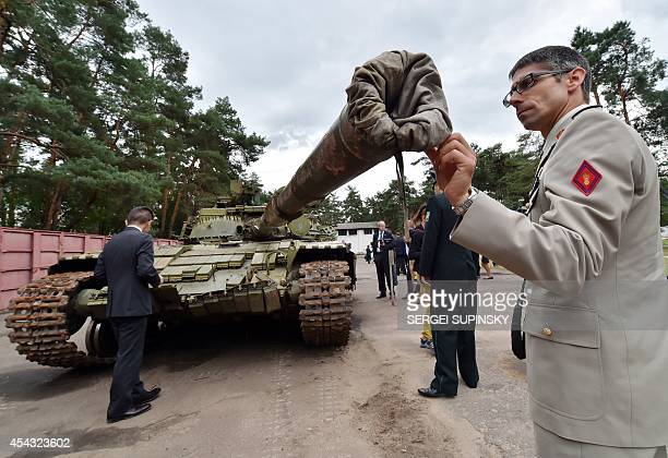Military attache examines a Russian T-64BV tank displayed in Kiev on August 29, 2014. Russian weapons and artillery, seized by Ukrainian forces from...