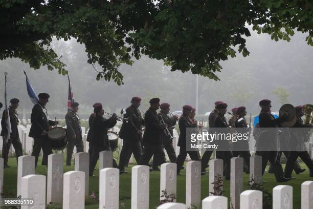 Military band arrives as Normandy veterans attend a official service of remembrance at Bayeux Cemetery during the D-Day 74th anniversary...