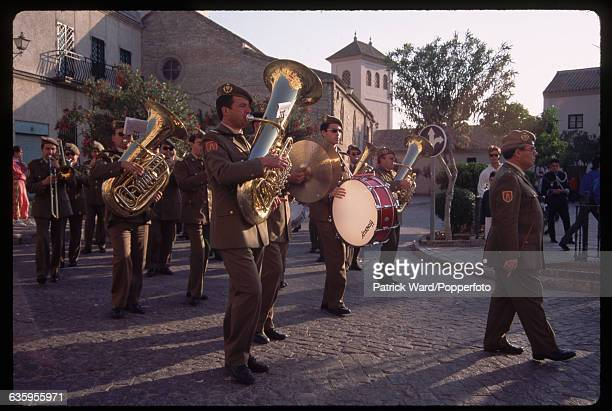 A military band attend a Holy Week procession at Castilleja de la Cuesta on Easter Sunday Spain | Location Castilleja de la Cuesta Spain