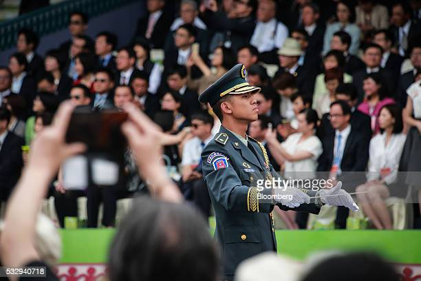 A military band conductor performs during the inauguration ceremony for Tsai Ingwen Taiwan's incoming president at the Presidential Palace in Taipei...
