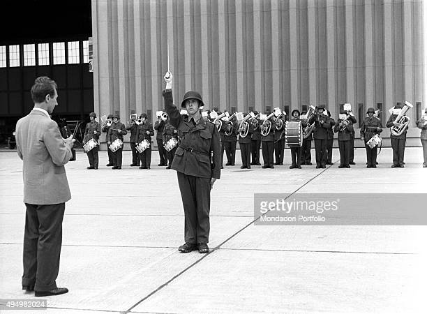 A military band getting ready to welcome the authorities at the airport of Geneva during the Summit to discuss global security German unification and...