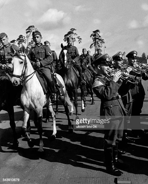 Military band is playing while horsemen are riding past Photographer Curt Ullmann Published by 'Hier Berlin' 36/1940Vintage property of ullstein bild