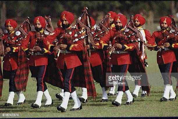 Military Band of army soldiers in ceremonial uniforms marching playing bagpipes in Rajasthan India