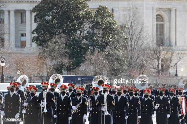 Military band participates in the dress rehearsal for the inauguration of President-elect Joe Biden at the U.S. Capitol on January 18, 2021 in...