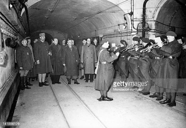 A military band playing in honour of the French General Henri Giraud on a visit to a gallery in the Maginot Line along with journalists France...