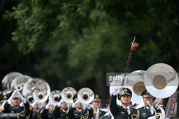Military band plays during a welcome ceremony for Portuguese President Anibal Cavaco Silva held by Chinese President Xi Jinping outside the Great...