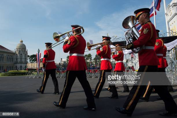TOPSHOT A military band plays music as they march into the presidential palace in Bangkok ahead of the arrival to the palace of Philippines'...