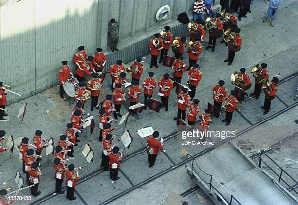A military band plays on the quayside as the Cunard liner 'RMS Queen Elizabeth 2' leaves Southampton having been requisitioned as a British troopship...