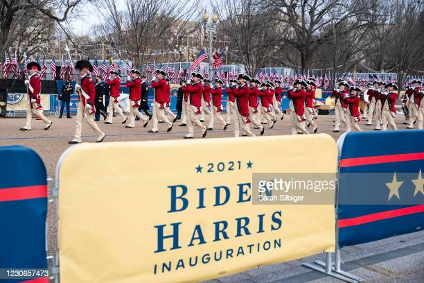 Military bands in period uniforms participate in a dress rehearsal of the inauguration parade on Pennsylvania Avenue in front of the White House on...