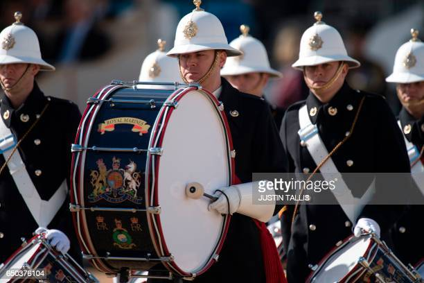 Military bands play during a Service of Commemoration and Drumhead Service on Horse Guards Parade in central London on March 9 which honours the...