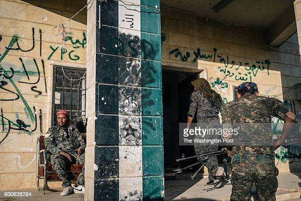 A military base displays graffiti made by several different armed groups who held control of the place in the past four years including the FSA ISIS...