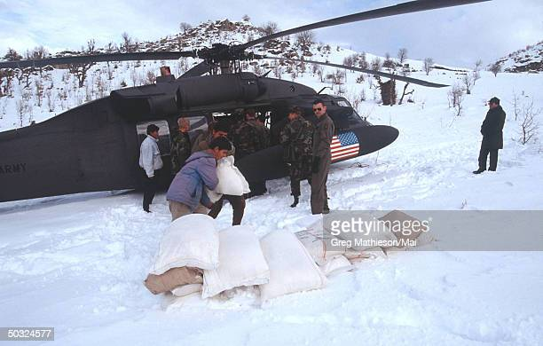 US military black hawk helicopter delivering food and supplies to Kurdish refugees in mountainous safe haven of Northern Iraq protected by the US...