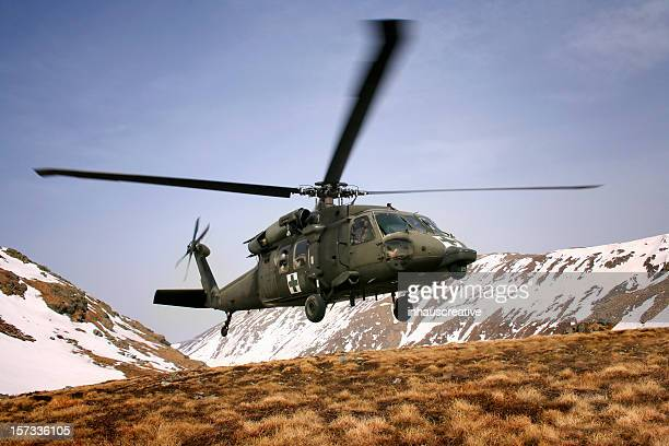 military blackhawk helicopter medical mountain rescue - medevac stock photos and pictures