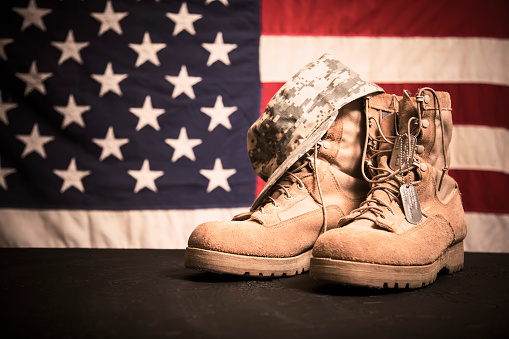 USA Military boots, hat and dog tags with flag. 936331026