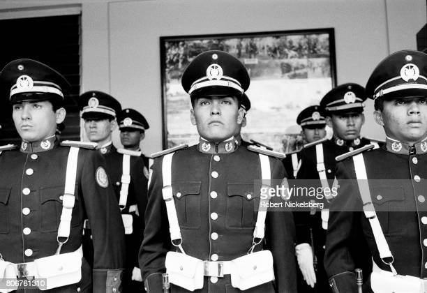 Military cadets at the Escuela Militar stand at attention during a military ceremony in San Salvador, El Salvador, August 11, 1984. Many cadets who...