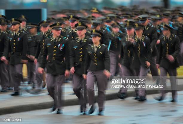 US Military cadets get into position to form an honor cordon as they wait for the arrival of the hearse carrying former US President George HW Bush...
