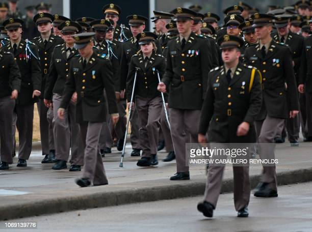 Military cadets get into position to form an honor cordon as they wait for the arrival of the hearse carrying former US President George HW Bush in...