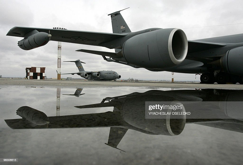 US military cargo planes sit on the runway at the US airbase