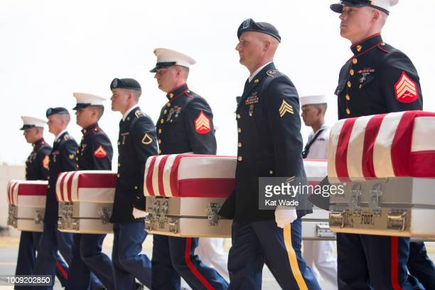 S military carry the presumed remains of Korean War soldiers at Hangar 19 Joint base Pearl Harbor Hickam on August 1 2018 in Honolulu Hawaii The...