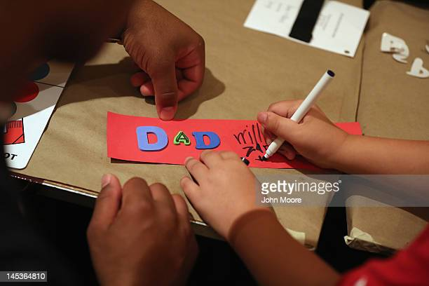 A military child makes artwork dedicated to his slain father at the TAPS 'Good Grief Camp' on May 27 2012 in in Arlington Virginia Five hundred...
