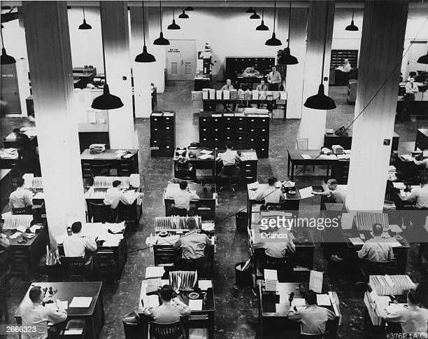 Military clerks at work in the Pentagon processing files concerning American army personnel