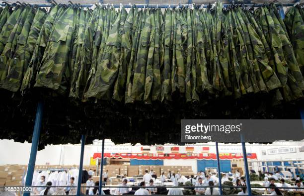 Military combat uniform trousers hang on a rack in the garment area at a PT Sri Rejeki Isman factory in Sukoharjo Java Indonesia on Wednesday March...