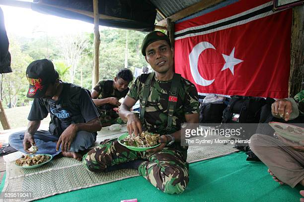 GAM Military Commander of Aceh Rayeuk and Aceh Besar districts Muharram eating his lunch at his camp in the hills near Banda Aceh Indonesia on Friday...