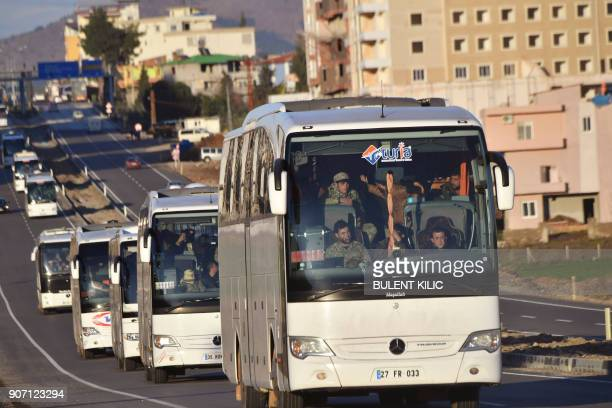 A military convoy carries Syrian opposition rebels backed by Ankara in Hassa Hatay Province near the TurkishSyrian border on January 19 2018 / AFP...