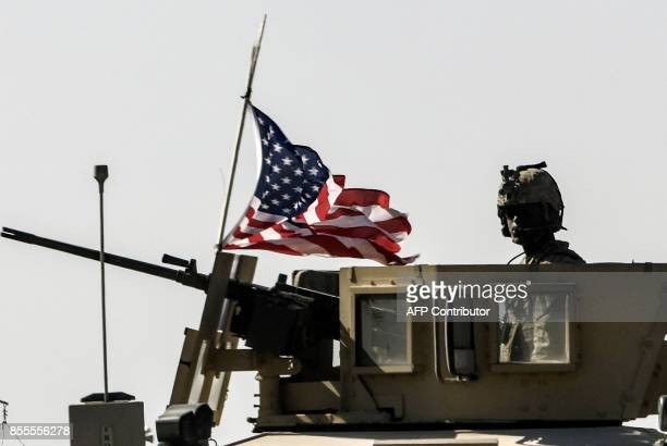 A US military convoy drives on a highway from Kobane to Ain Issa on September 29 2017 After a monthslong campaign the Syrian Democratic Forces a...