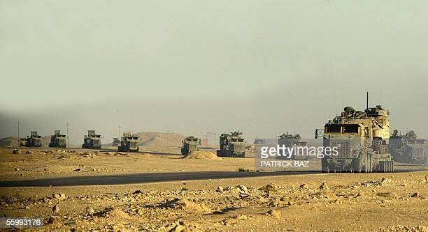 Military convoy drives through the Anbar desert toward the town of al-Qaim at the Iraqi-Syrian border 24 October 2005. The most powerful military...