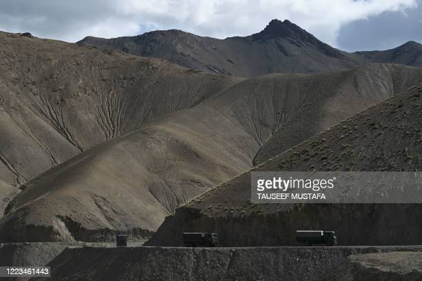 Military convoy drives towards Leh along the Srinagar-Leh Highway on June 29, 2020.