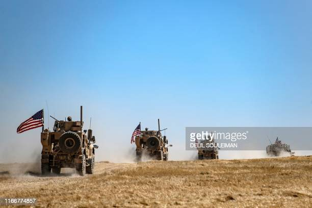 Military convoy takes part in joint patrol with Turkish troops in the Syrian village of al-Hashisha on the outskirts of Tal Abyad town along the...