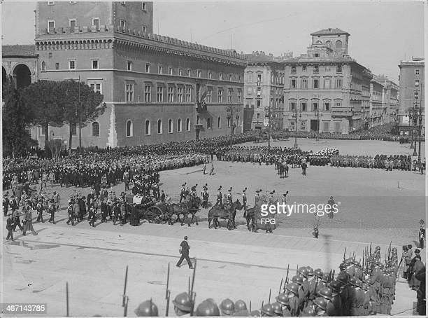 A military cortage passing the Italian tomb of the unknown soldier in Piazza Venezia Rome Italy 1921