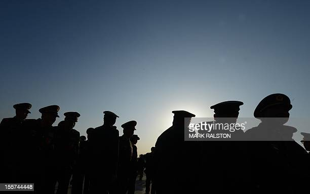 Military delegates arrive for the opening session of the Chinese Communist Party's five-yearly Congress at the Great Hall of the People in Beijing on...
