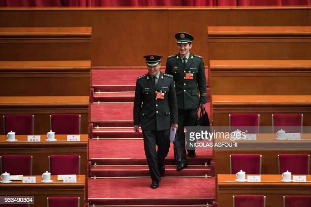 Military delegates arrive for the sixth plenary session of the National People's Congress during a vote to extend Li's term at the Great Hall of the...