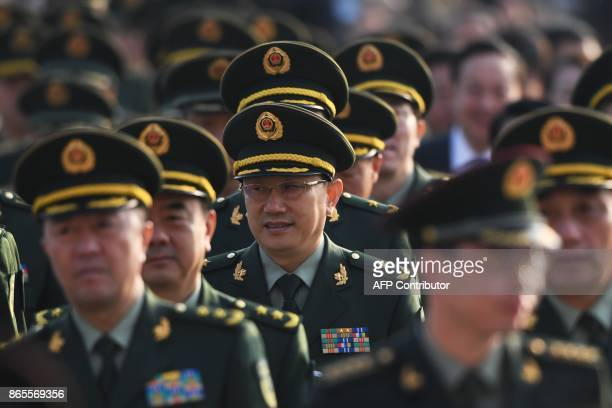 Military delegates arrive outside the Great Hall of the People for the closing session of the 19th Communist Party Congress in Beijing on October 24...