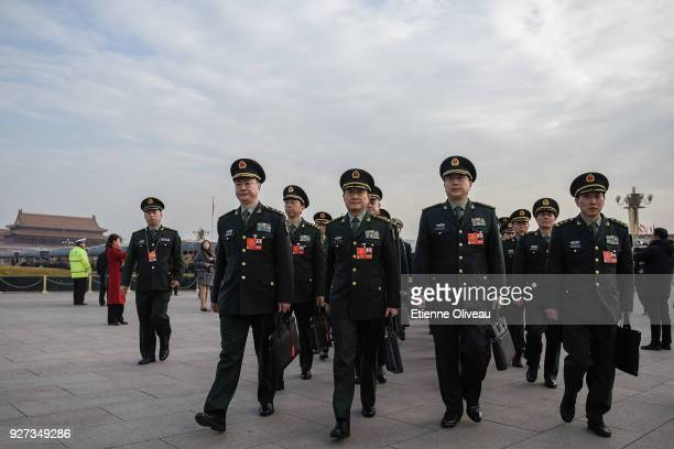 Military delegates arrive to attend the opening session of the 13th National People's Congress at The Great Hall of People on March 5, 2018 in...