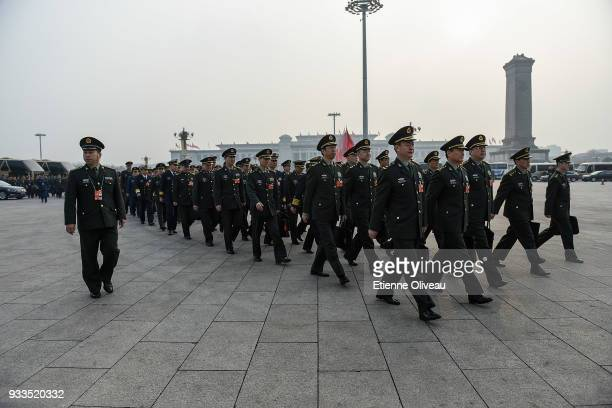 Military delegates arrive to attend the sixth plenary session of the National People's Congress at the Great Hall of the People on March 18 2018 in...