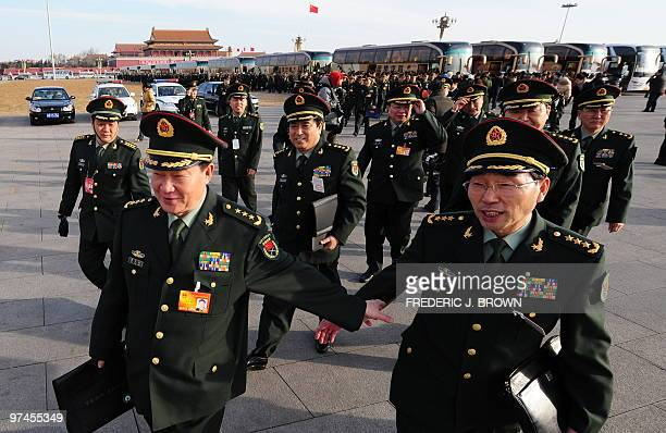 Military delegates head to the Great Hall of the People upon arrival on Tiananmen Square for the opening session of the National People's Congress in...