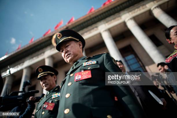 Military delegates leave the Great Hall of the People at the end of the opening of the National People's Congress in Beijing on March 5 2017 China's...