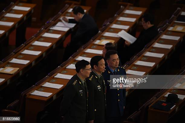 Military delegates pose for photos in Beijing's Great Hall of the People before the third plenary session of the National People's Congress on March...