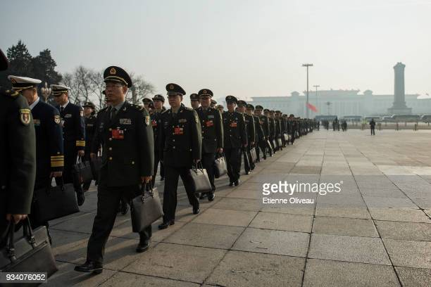 Military Delegates walk toward the Great Hall of the People before the seventh plenary session of the 13th National People's Congress on March 19,...