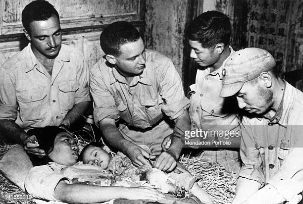 US military doctors under a Chinese department treating a woman and a child wounded Hainan September 1944
