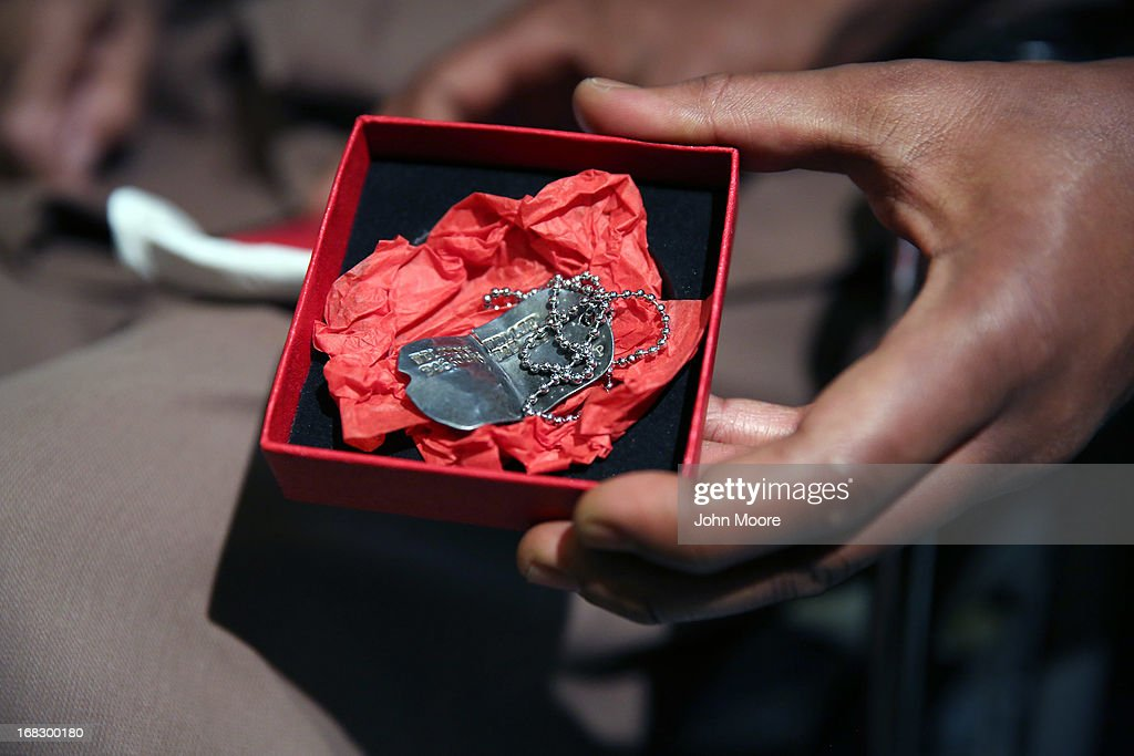 Military dog tags are shown after being returned to 90-year-old WWII veteran Willie Wilkins at the Newark City Hall on May 8, 2013 in Newark, New Jersey. Newark Mayor Cory Booker, who has declared that he will run for New Jersey's open U.S. Senate seat in 2014, honored the 90-year-old WWII veteran on the 68th anniversary of Victory in Europe Day. At the ceremony, Wilkins received his dog tags, which were recently unearthed in a French garden, some 67 years after he lost them in France during WWII.