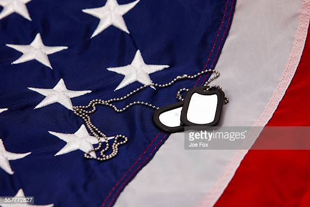 military dog tags lying on usa flag - military dog tags stock pictures, royalty-free photos & images