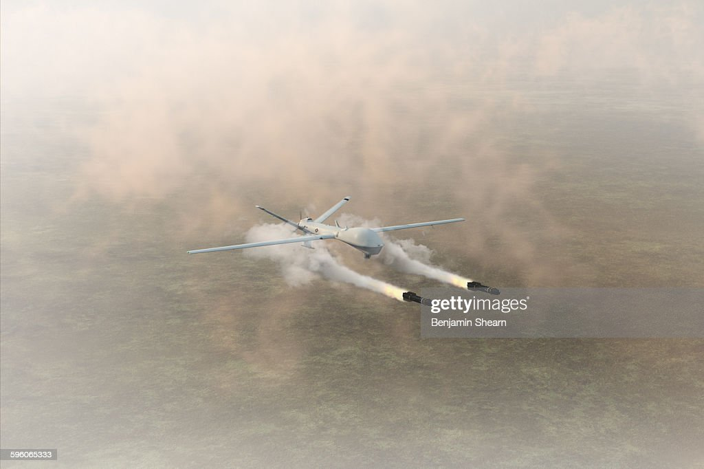 Military Drone Firing Missiles Stock Photo