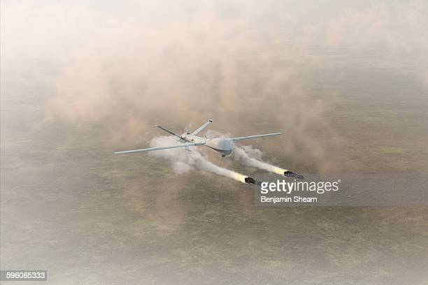 military drone firing missiles - military drones stock photos and pictures