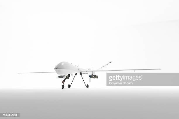 military drone on white - military drones stock photos and pictures