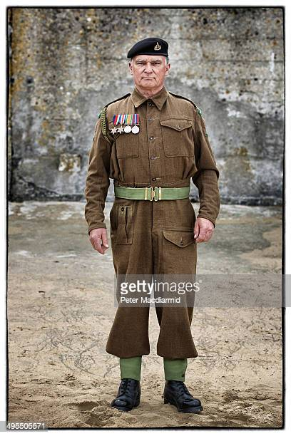 Military enthusiast Frank Mumby from the United Kingdom wears a replica uniform of a member of the British 53rd Welsh Reconnaissance Regiment on June...
