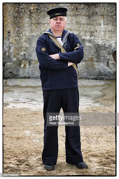 Military enthusiast Joseph Smith from the United Kingdom wears a replica uniform of an British Royal Navy Rating on June 3 2014 in Arromanches France...